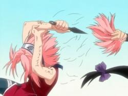 Sakura cutting her hair.jpg